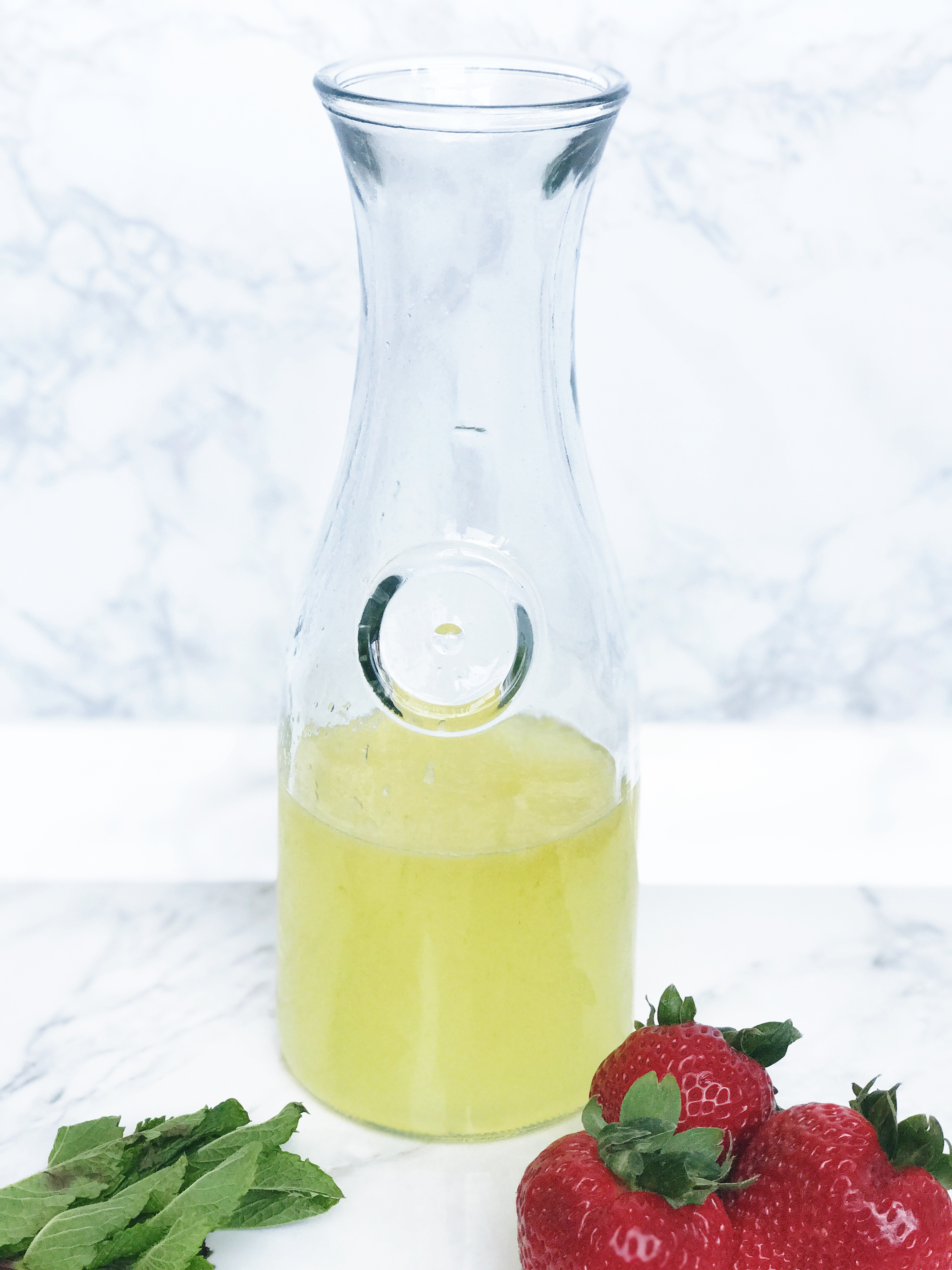 ingredients for strawberry martini made with lemoncello and mint