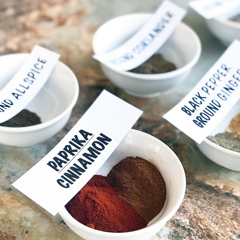 Paprika cinnamon black pepper ground ginger ground allspice and other North African spices and herbs