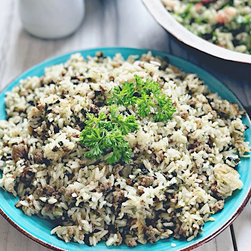 Israeli lamb rice, displayed in a light blue dish, and finished with a touch of parsley.