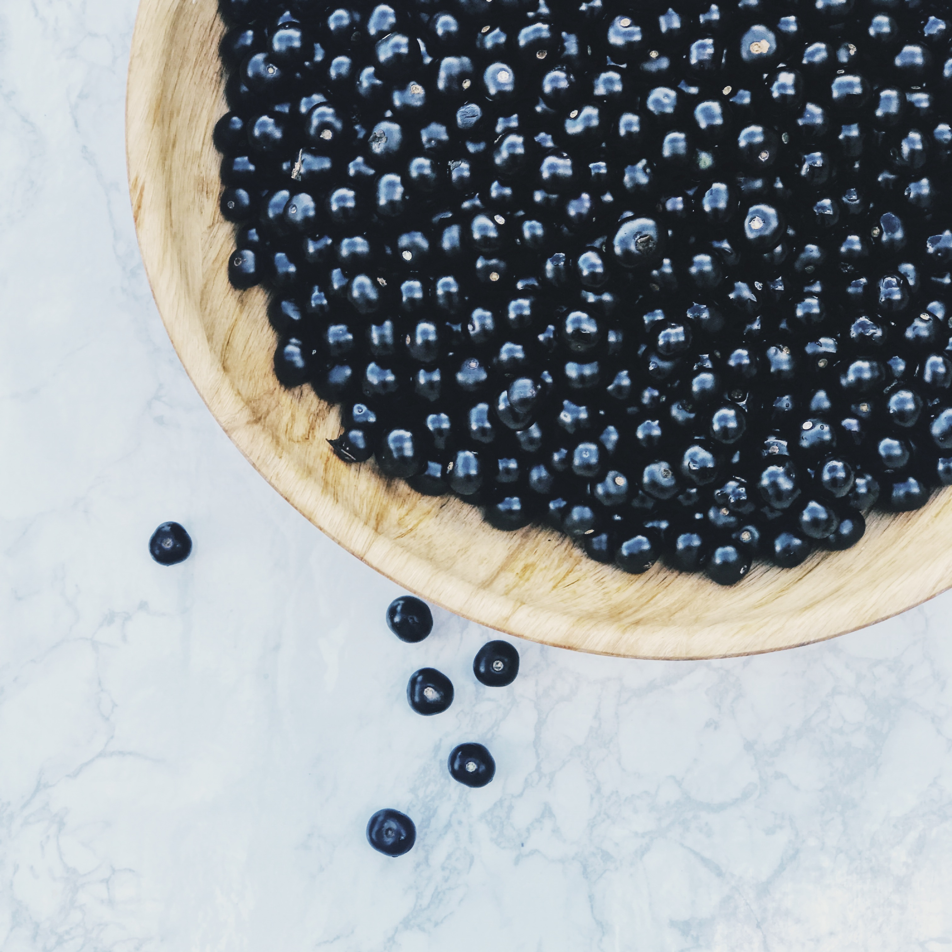 huckleberries on a wooden board