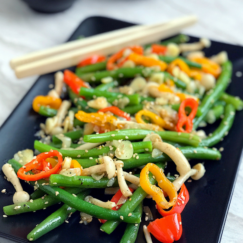 healthy vegetable stir fry recipe with garlic, sesame, green beans, pepper, and mushrooms